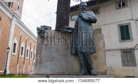 Statue of the famous mathematician Ulisse Dini in Piazza di Cavalieri, Pisa, Italy