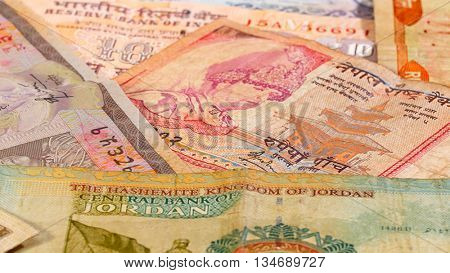 Different asian currency bank notes business background