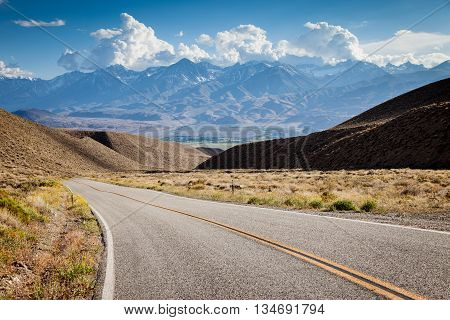Road in California with mountains on the horizon