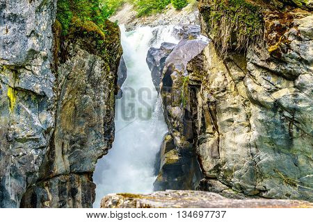 Water Cascading down Nairn Falls in Nairn Falls Provincial Park between Whistler and Pemberton in British Columbia, Canada poster