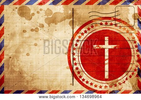Christian cross icon, red grunge stamp on an airmail background