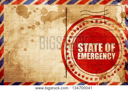 state of emergency, red grunge stamp on an airmail background