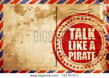 talk like a pirate, red grunge stamp on an airmail background