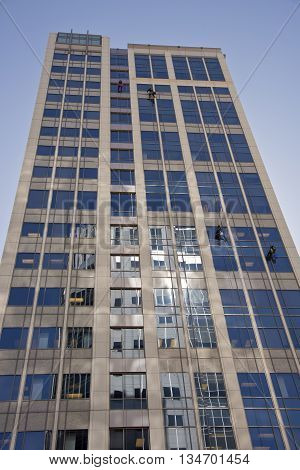 Window washers on a high rise building in Salt lake city Utah.