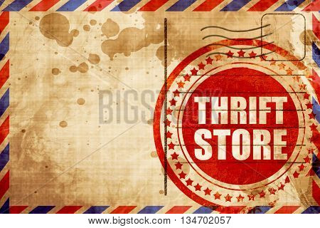 thrift store, red grunge stamp on an airmail background