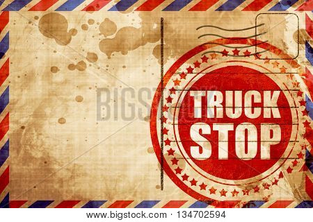 truck stop, red grunge stamp on an airmail background