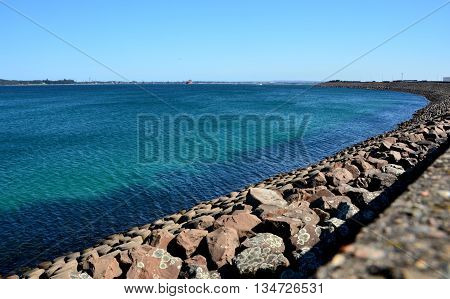 Long rampart separates the industrial area from the sea in Yarra Bay.