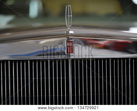 CRACOW POLAND - MAY 21 2016: Lincoln Continental Mark VI metallic logo closeup on Lincoln Continental Mark VI car displayed at 3rd edition of MOTO SHOW in Cracow Poland.