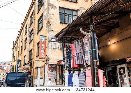 St.Petersburg Russia - May 18 2016: Clothing trading on Apraksin marketplace.