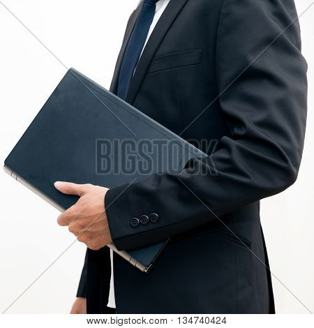 Portrait Of Young Asian Business Man Black Suit Holding Laptop Computer Device