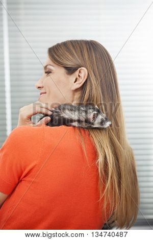 Happy Woman With Weasel On Shoulder