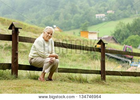 Portrait of senior woman realxing in a garden