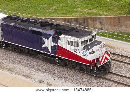 DALLAS USA - APR 8: Trinity Railway Express train (TRE) in the city of Dallas. April 8 2016 in Dallas Texas USA