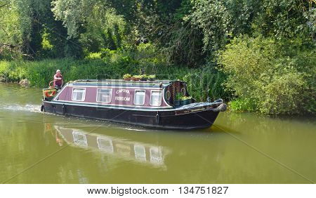 Offord Cluny, Cambridgeshire, England - June 09, 2016: Traditional Narrow boat on the river Ouse at Buckden Marina Cambridgeshire.