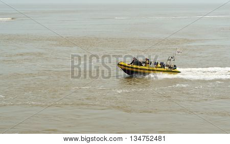 Felixstowe, Suffolk, England - June 11, 2016: Small Inflatable power boat in the North Sea  at Felixstowe Suffolk England.