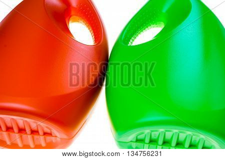 colorful abstract background made with plastic bottles of liquid detergent, it seems 2 wrestlers fightin and gnashing their teeth
