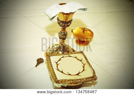 Golden Chalice With Consecrated Hosts In A Christian Church