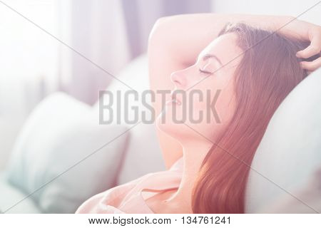 Happy Young Woman Lying On Couch And Relaxing At Home. Casual St