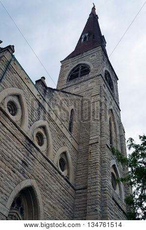 Looking up towards the belfry of the Saint Mary Carmelite Church, an abandoned Roman Catholic church in downtown Joliet, Illinois.
