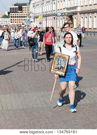 Moscow - May 9 2016: Protesters Immortal regiment with St. George ribbons go after the demonstration May 9 2016 Moscow Russia