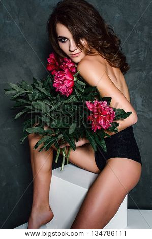 Beautiful Sexy Stylish Young Adult In Lingerie With Nice Bouquet Of Pink Peonies. Studio Retouched S