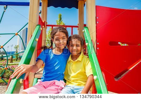 African american brother and sister having fun at the playground on a sunny summer day