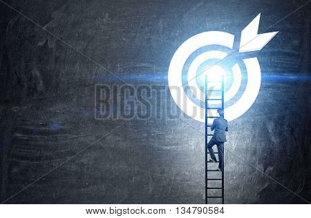 Targeting concept with businessman climbing ladder to abstract illuminated dartboard sketch on chalkboard