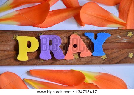 word pray on a abstract colorfuk background