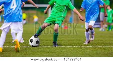 Youth soccer football teams kicking soccer ball on a sports pitch. Soccer tournament for young footballers. poster