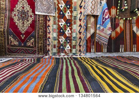 Colorful oriental handmade carpets and rugs outside of a shop.