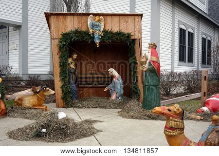 HARBOR SPRINGS, MICHIGAN / UNITED STATES - DECEMBER 24, 2015: A Nativity Scene stands outside the Holy Childhood of Jesus Parish Hall on Christmas Eve.