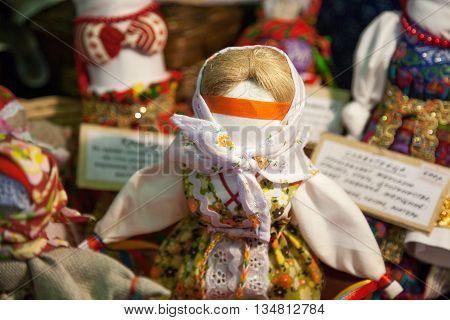 Russia Khabarovsk - May 1 2016: Traditional Russian rag doll at Slavic culture fair. Handmade art textile faceless toy girl souvenir market