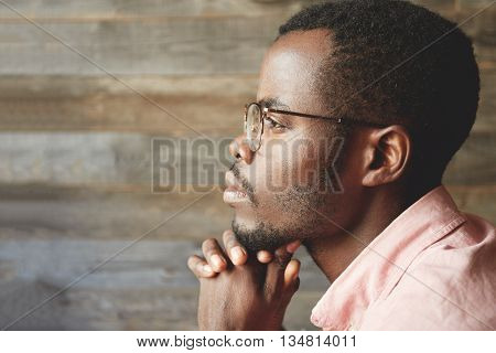 Profile Headshot Of Young Black Man In Glasses, With Hairy, Healthy Face, Looking Into The Distance,