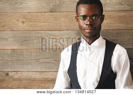 Upper Body Shot Of Intelligent African-american Man In Round Glasses And White Official Shirt. This