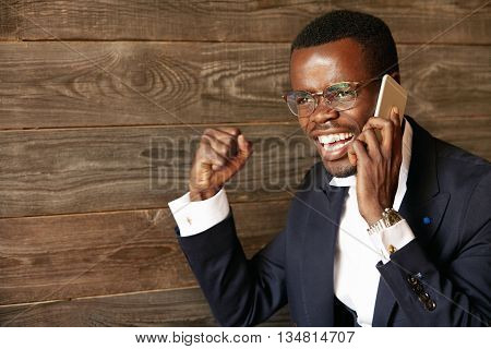 Success And Achievement. Successful African Entrepreneur, Talking On Cellphone With Happy Expression
