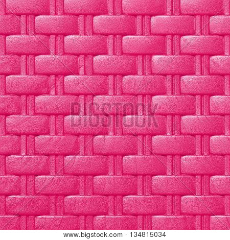 Plastic weave pattern texture and background; pink color