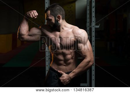 Young Bodybuilder Flexing Muscles Double Biceps Pose