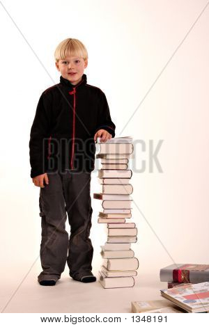 Young Boy With A Pile Of Books