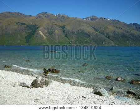 Lake Wakatipu in the Otago mountains on a clear day