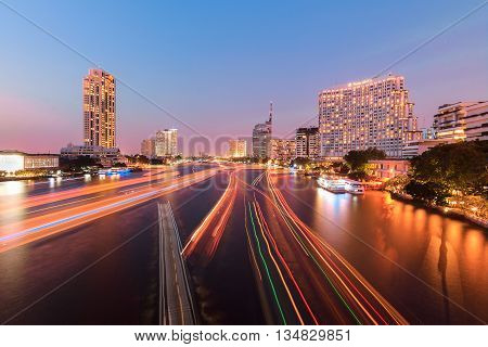 Bangkok, Thailand - December 21, 2013 : view of Chao Phraya River side building taken from Saphan Taksin bridge. Chao Phraya is the main river of Bangkok in living and transportation