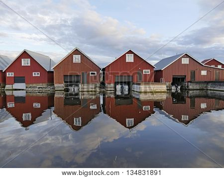 Fisherman cabins on the Swedish east coast in sunset