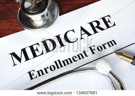Medicare enrollment form written on a paper.  Medical concept.