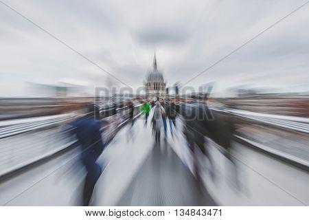 April 2016 - London England: Blurred photo of people crossing Millenium Footbridge