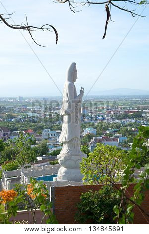 View of the sculpture of the Bodhisattva Avalokitesvara (Goddess of Mercy) in the early evening. Phan Thiet, Vietnam