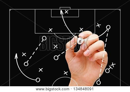 Coach drawing soccer game tactics with white marker on transparent wipe board over black background. Football manager explaining game strategy.