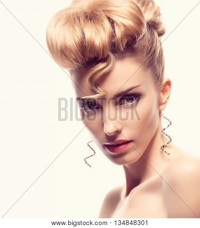 Fashion natural makeup. Beauty woman with mohawk hairstyle. Blonde nude sexy model girl, shiny hair makeup, long eyelashes, perfect skin. Creative unusual mohawk hairstyle.Skincare concept, model head