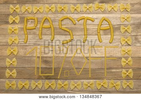 pasta ten percent off text made of raw pasta on wood