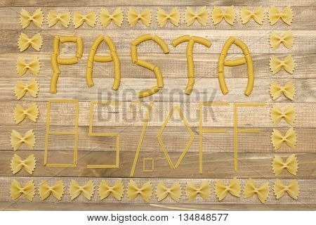 pasta eighty five percent off text made of raw pasta on wood