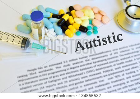 Syringe with drugs for Autistic disease treatment, blur text