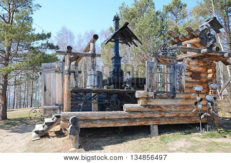 Irkutsk region Russia - May10 2015: The sculpture composition of schematic internal and external decoration of Russian hut